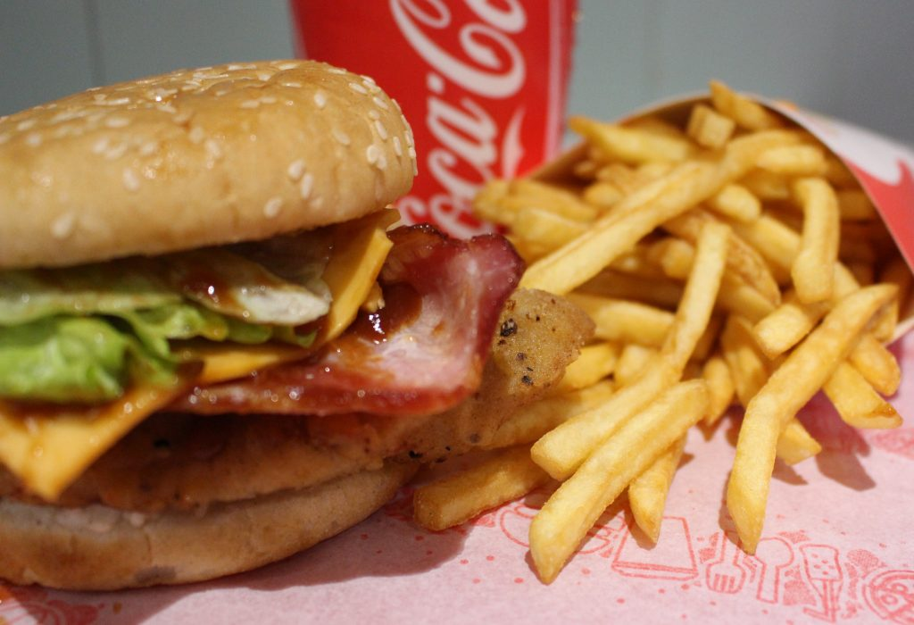 Chicken and bacon burger with fries and drink