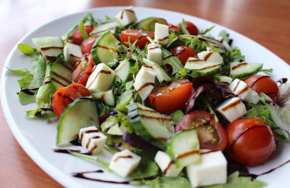 Cheese salad with tomato and cucumber