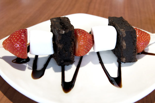 Chocolate brownie, marshmallow and strawberry kebab