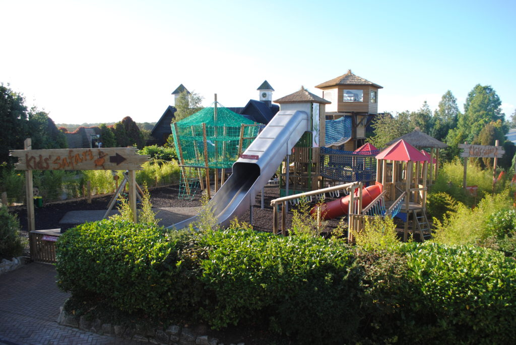 Large outdoor play area with nets and slides