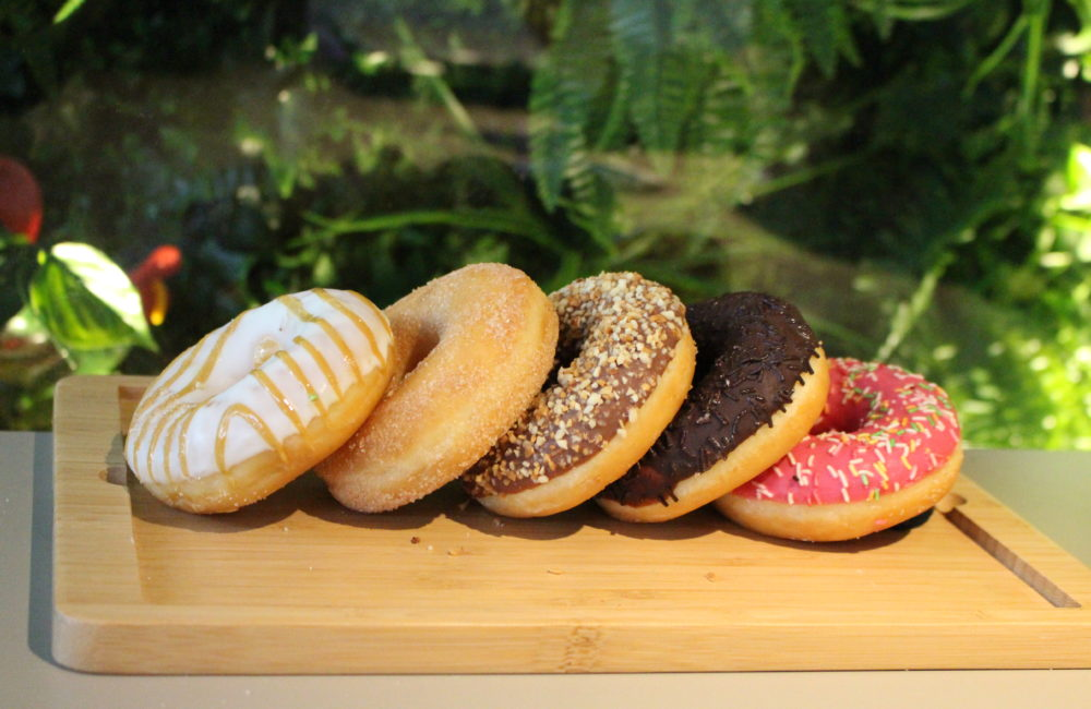 Selection of doughnuts on a wooden board