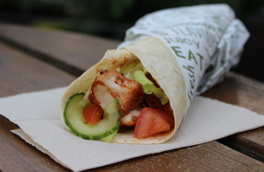 Chicken and salad wrap served in food paper