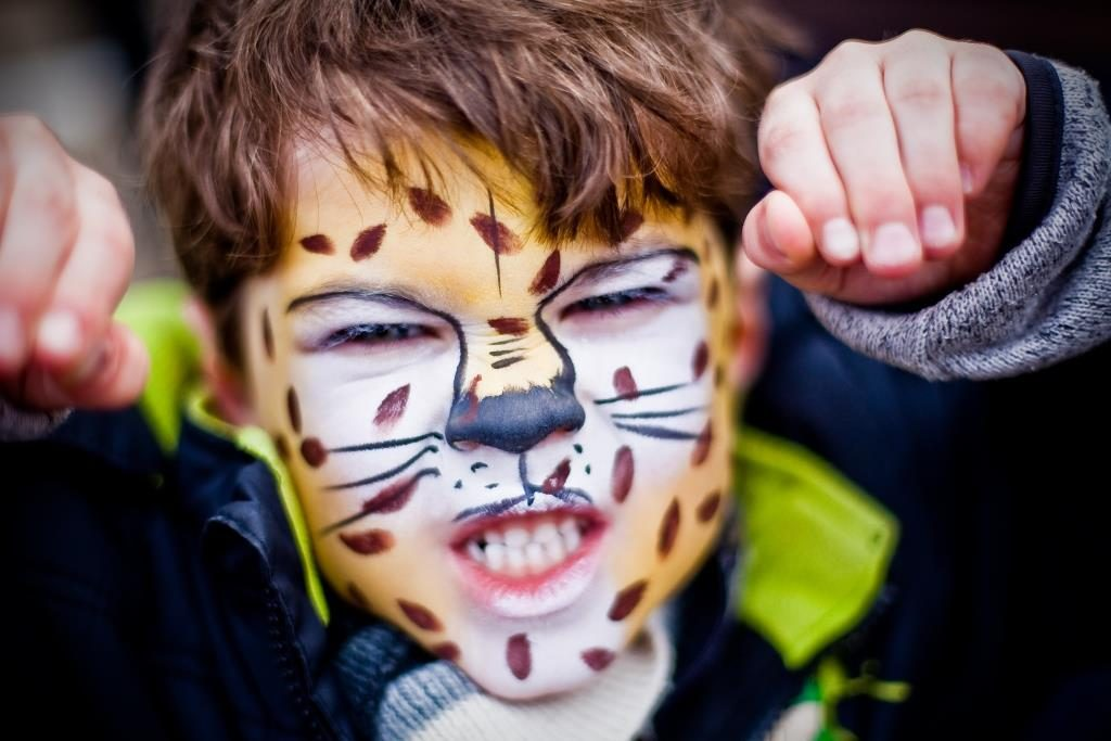 Young boy with tiger face painting