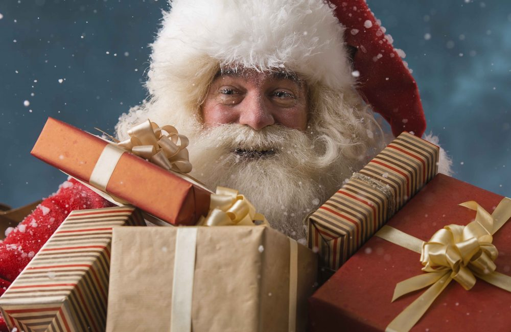 Close up of Santa carrying presents